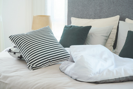 untidy: Messy bed with pillows in modern interior  bedroom