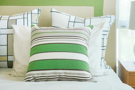 modern living room: Closeup green stripped pillow on bed