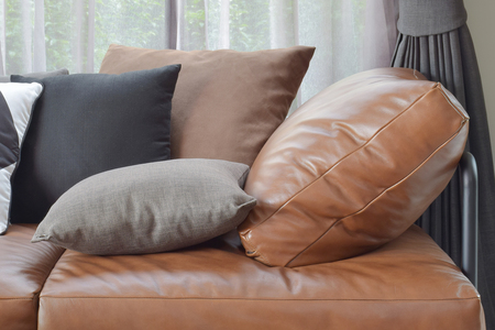 t brown leather sofa bed with varies color and size pillows