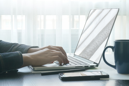 female hands typing on notebook keyboard.concept of business people work from anywhere with technology Stock Photo