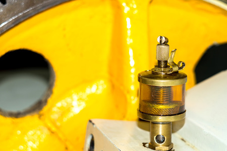 oiler: Oiler Mechanism in workshop. Automatically lubricates machine.