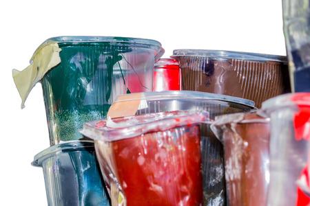 printmaking: Old ink in the plastic jars. Printing workshop Stock Photo