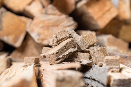 briquettes: Briquettes for firing, ignition on the background of wood. View from side Stock Photo