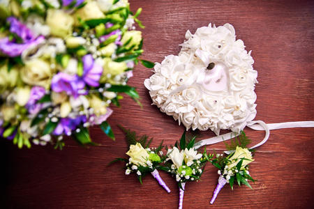 attributes: Wedding attributes. Rings, bridal bouquet and boutonniere Stock Photo