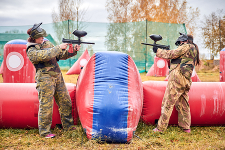 paintball: Paintball sport player girls in protective camouflage uniform
