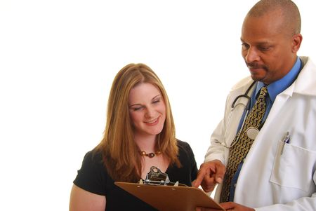 African american male doctor showing a caucasian female something on a clipboard.
