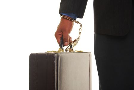 African american male wearing a business suit handcuffed to a briefcase.