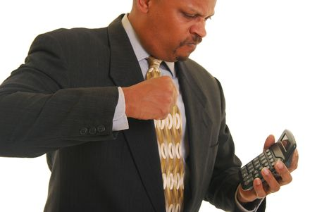 African american businessman angry and punching a calculator Stock Photo