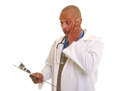 Sweating African American doctor shocked and scared by information on a clipboard.
