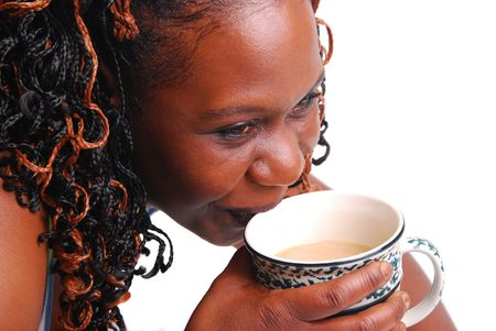 African American woman drinking coffee, isolated on white. Stock Photo