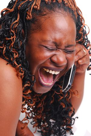 African American girl talking on cell phone laughing.