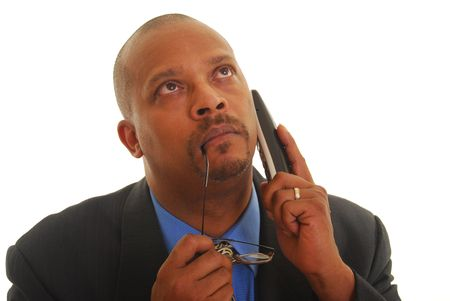 African American business man talking on phone thinking, isolated on white. Stock Photo