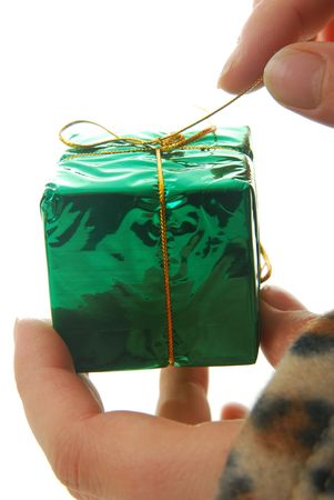 person opening gift isolated on white, focus on present.