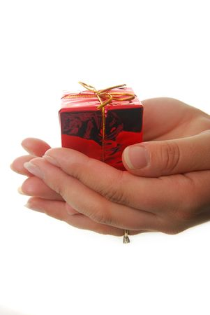 hands holding red gift isolated on white