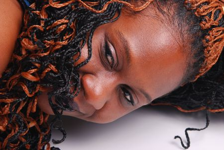 African American woman laying down, focus on eyes.