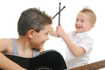 Caucasian children playing music isolated on white