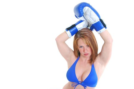 middle aged sexy female with boxing gloves isolated on white.
