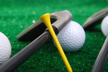 golf set laying on grass focus on tee.