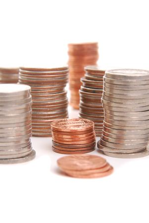 stacks of coins, focus on pennies, isolated on white. Stock Photo