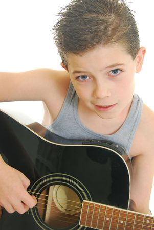 young boy playing acoustic guitar isolated on white. Stock Photo