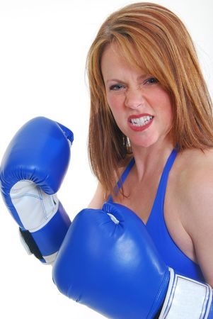 middle aged woman boxing isolated on white. photo