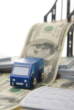 toy van driving off money bridge focus on van.