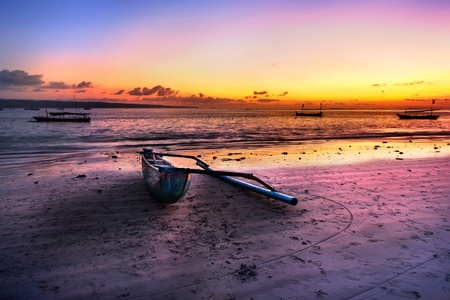 Drifting boat on the beach at sunset time . Bali , Indonesia photo