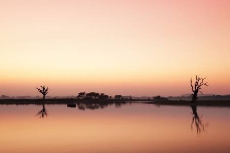 Sunset at big lake in Amarapura city, Myanmar photo