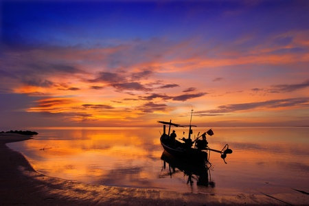 yellow boats: Sunrise and Fishermen boat silhouette in Thailand Stock Photo