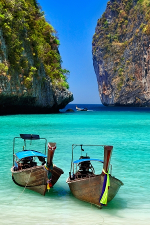 Traditional Thai boats in the bay of Phi-Phi island,  Thailand photo