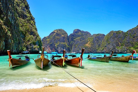 Many traditional Thai boats in the Maya Bay of Phi-Phi island