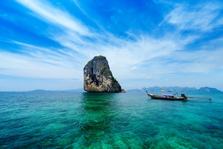 paradise bay: Traditional Thai boat in the blue sea of Thailand