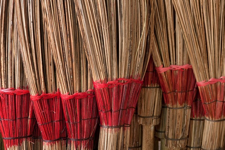 Coconut leaf broom .  A wisdom of villagers made of coconut leaves used in the home. photo