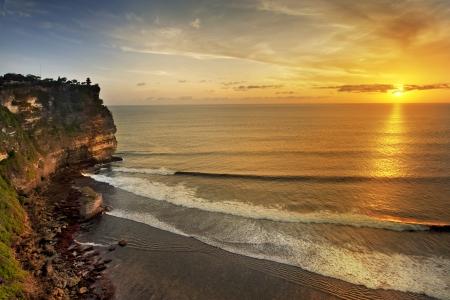 temple mount: Sunset from the Pura Uluwatu temple on Bali island in Indonesia Stock Photo