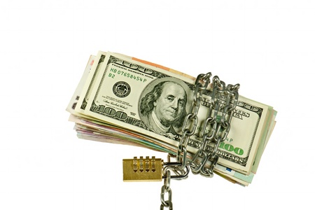 Dollars and other notes  with chain on white background Stock Photo - 8953713
