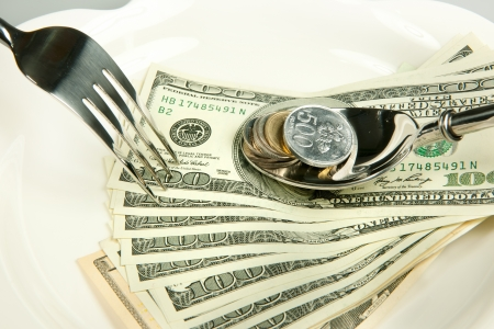 paper plates: money are food for everbody denomination on plate.