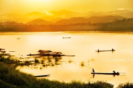 Fisherman in sunset background  photo