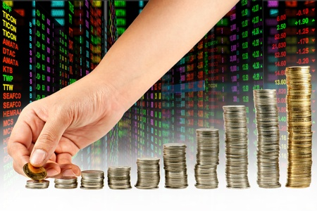 Hand make coin to graph in stock background Stock Photo - 9881898