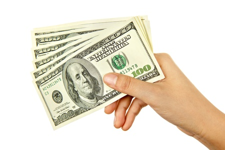cash on hand: Hand holding money in US dollar