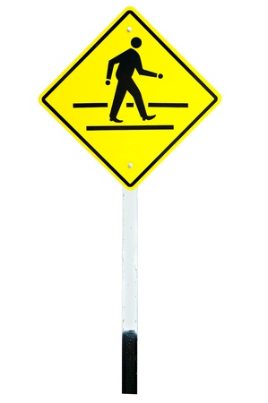 yellow traffic sign crossing road photo