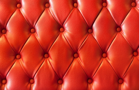 plain button: background image of plush red leather  Stock Photo