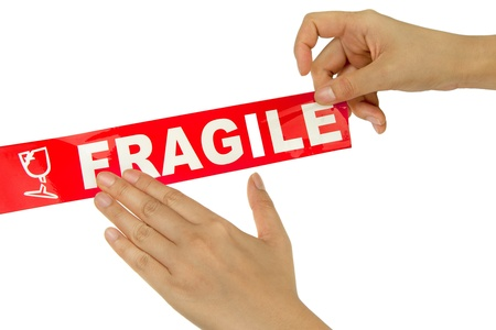 parsel: Hand stick red fragile tape