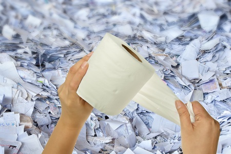 Hand holding tissue in paper waste background photo
