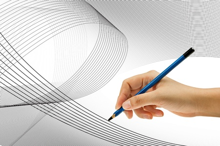 Drawing with pencil in woman hand  photo