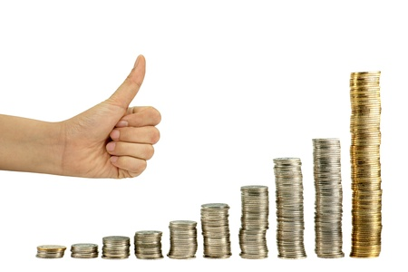 Hand showing good graph  from coin Stock Photo - 10832864