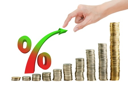 Hand pulling percentage on coin graph Stock Photo - 10832905