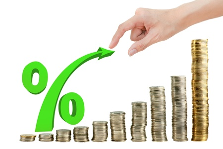 Hand pulling percentage on coin graph Stock Photo - 11098892