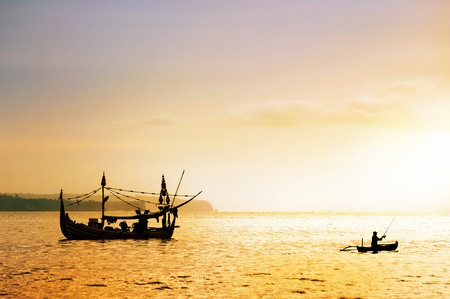 local fishing boat on the beach at sunset time . Bali , Indonesia photo