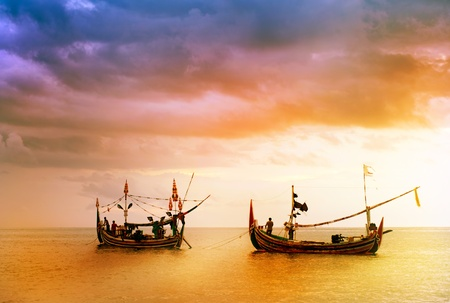 local fishing boat on the beach at sunset time . Bali , Indonesia