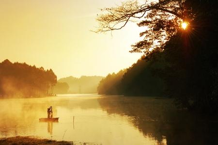 fishing huts: Fisherman in sunrise background  Stock Photo